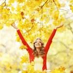 Happy woman in autumn park — Stock Photo #34744825