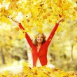 Happy woman in autumn park — Stock Photo