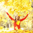 Happy woman in autumn park — Stock Photo #34744901