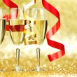 Champagne and ribbons — Stock Photo #34745731