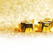 Golden gifts and ribbon — Stock Photo