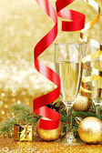 Champagne and new year decoration — Stock Photo