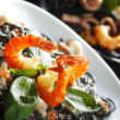 Black spaghetti with seafood — Stock Photo