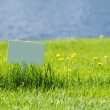 White signboard on grass — Stock Photo