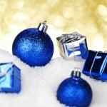 Christmas balls and gifts — Stock Photo #35146537