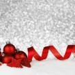Red christmas decoration on snow — Stock Photo