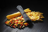 Variety of types and shapes of Italian pasta — Stock Photo