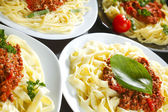 Spaghetti bolognese with basil — Stock Photo