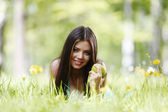 Woman with apple outdoors — Stock Photo