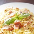 Spaghetti carbonara with fried bacon — Stock Photo