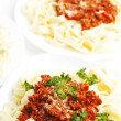 Plates with spaghetti bolognese — Stock Photo