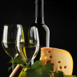 White wine and cheese on black — Stock Photo #36537483