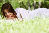 Woman sleeping on grass — Stock Photo
