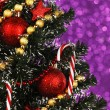Decorated Christmas tree on glitter background — Stok fotoğraf