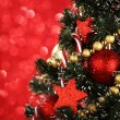 Decorated Christmas tree on glitter background — Foto Stock