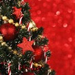 Decorated Christmas tree on glitter background — Stock Photo