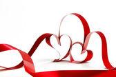 Red heart ribbons — Zdjęcie stockowe