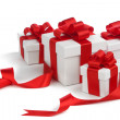 White gift boxes with red ribbon — Stock Photo