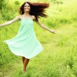 Woman running on meadow — Stock Photo