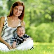 Mother and daughter on grass — Stock Photo #40817221