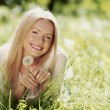 Woman in the park with dandelions — Stock Photo #40817227
