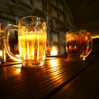 Foto Stock: Mugs of beer