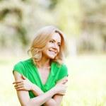 Woman sitting on grass — Stock Photo #48739069