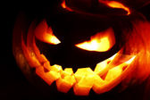 Glowing Halloween pumpkin — Stock Photo