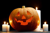 Halloween pumpkin with candles — Stock Photo
