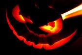 Glowing Halloween pumpkin — Stock Photo