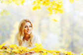 Woman laying in autumn park — Stock Photo