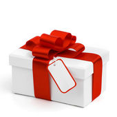 Holiday gift and tag — Stock Photo