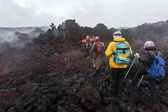 Group of tourists hiking on lava field eruption Tolbachik Volcano on Kamchatka Peninsula. Russia — Stock Photo