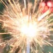 Christmas tree, red ball and lit sparkler. — Stock Video