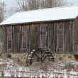 Old water mill in Waterloo, Ontario in snowy day. — Video