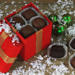 Christmas chocolate candies in winter snow — Stock Photo