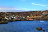 Brigus Cove Newfoundland, part of village and junks of Iceberg — Stock Photo