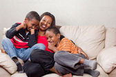Loving mother with her sons — Stock Photo