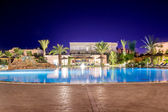 Swimming pool at night — Stock fotografie