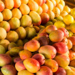 Ripe mangos at market — Stock Photo #18756875