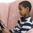 Young boy studying on a tablet PC — Stock Photo #5111378
