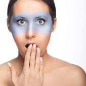 Surprised blue eyed girl with blue mask — Stock Photo