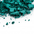 Crushed green eye shadow on white background — Stock Photo #27348555