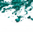 Crushed green eye shadow on white background — Stock Photo #27348595