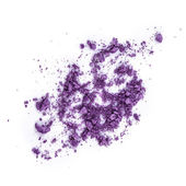 Crushed purple eye shadow on white background — Stock Photo