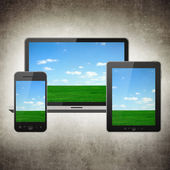 Grunge tablet pc, mobile phone and notebook — Stock Photo