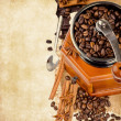 Coffee grinder with coffee beans — Stock Photo