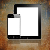 Tablet with phone on brown — Stock Photo