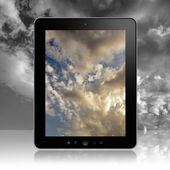 Tablet pc with sky screen — Stock Photo
