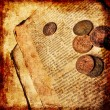 Old decrepit book with copper coins — Stock Photo #40772945
